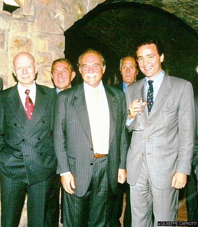 Giuseppe e Bernardo Caprotti, nelle cantine di Ca' del Bosco, nel 2003. Tra di loro il signor Paolo De Gennis